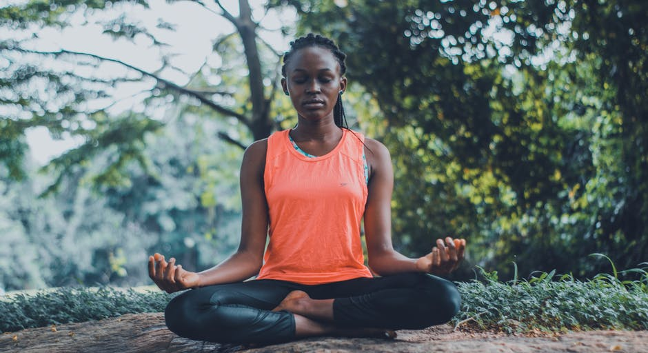A girl practicing the meditative easy pose