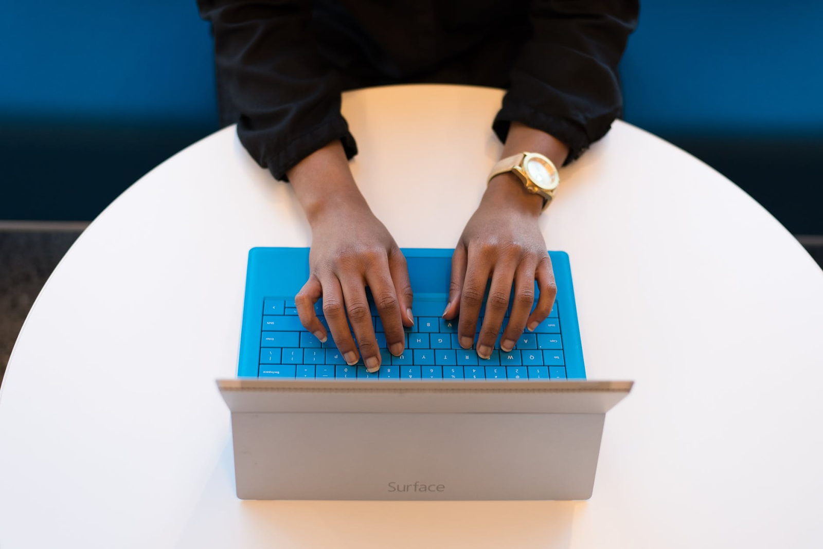 a person typing on a word processor