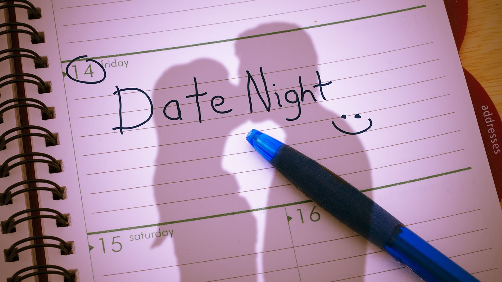 A planner showing a date night scheduled for Friday.