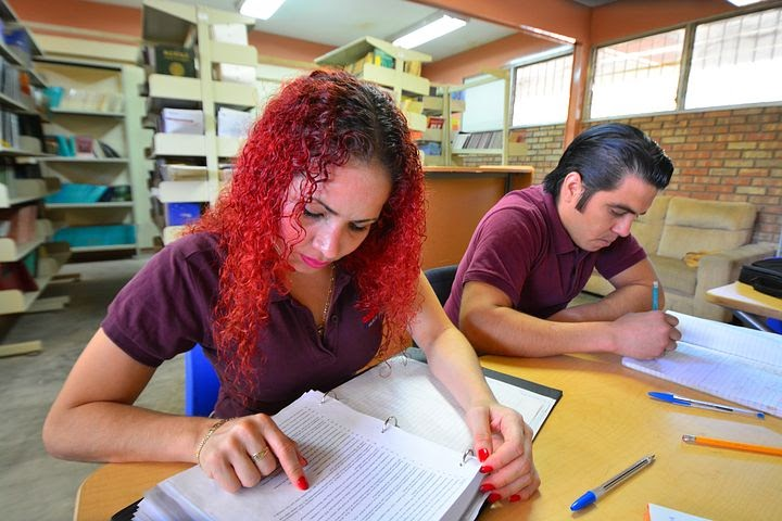 two friends study together on campus