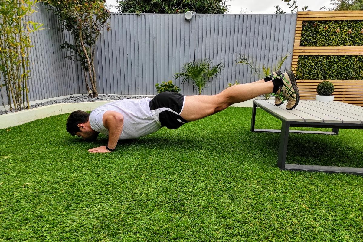 man doing incline push up
