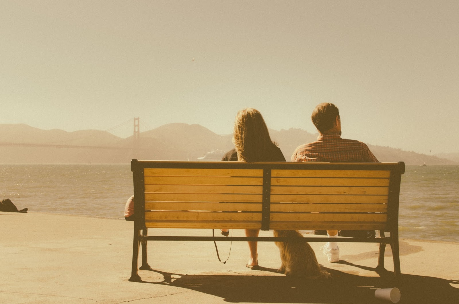 A couple looking at the Golden Gate Bridge.