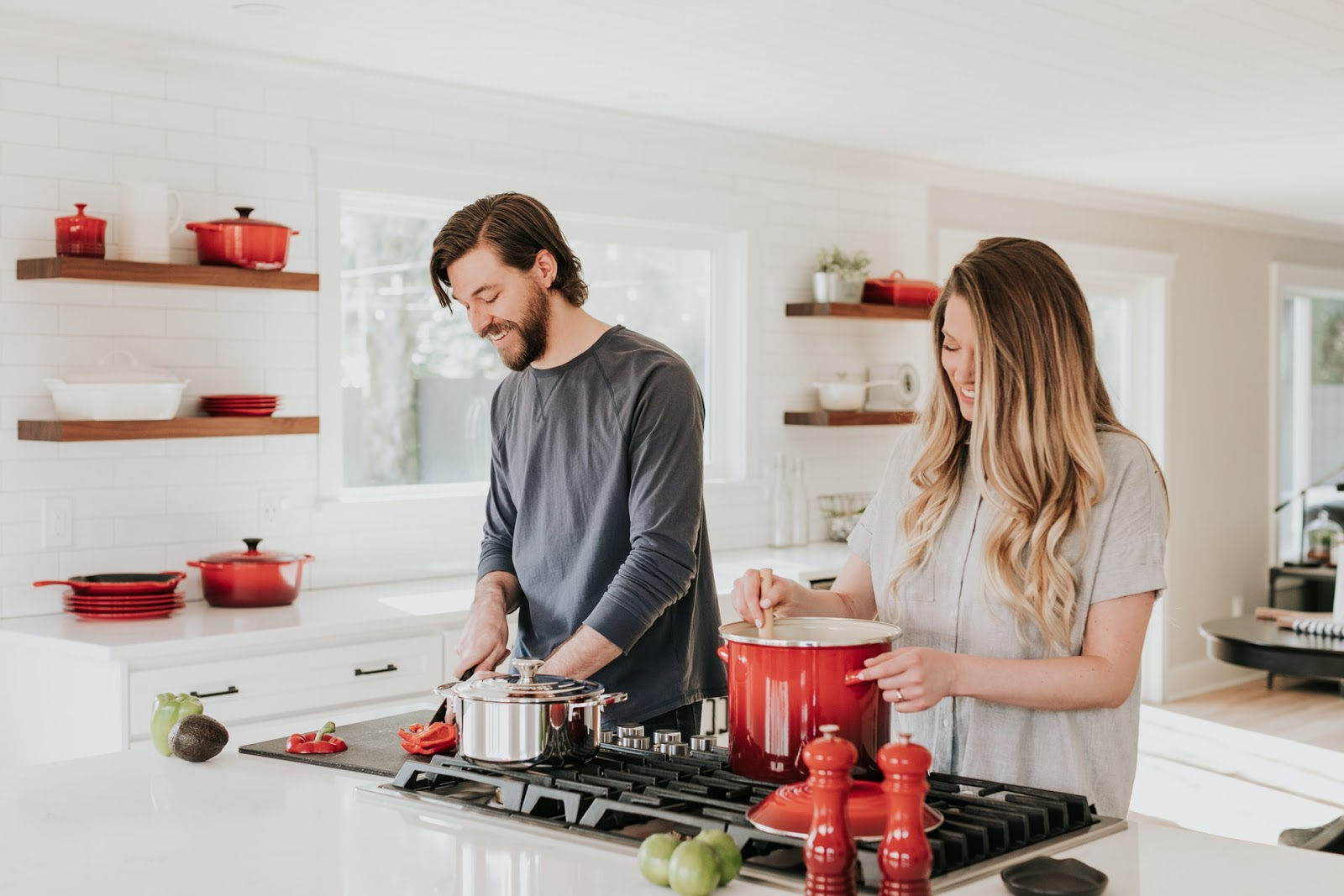 A couple cooking together.