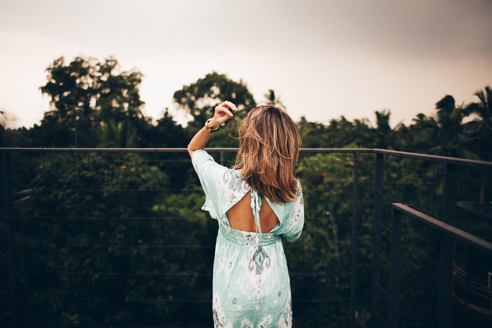 A woman on a balcony.
