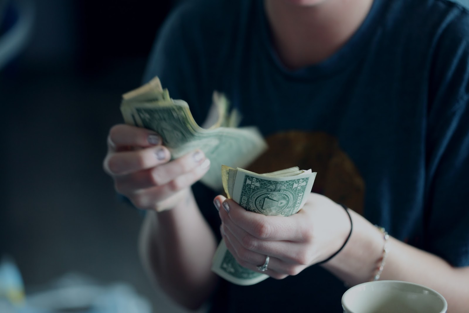 A person counting money.