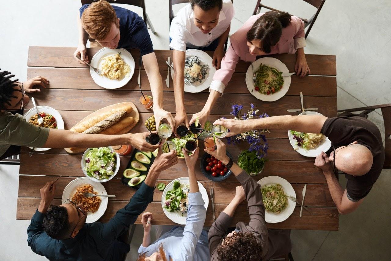 post college friends having dinner together