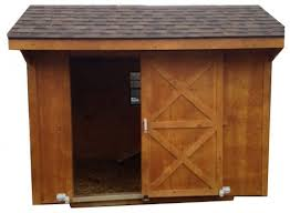 Wooden goat house with roof