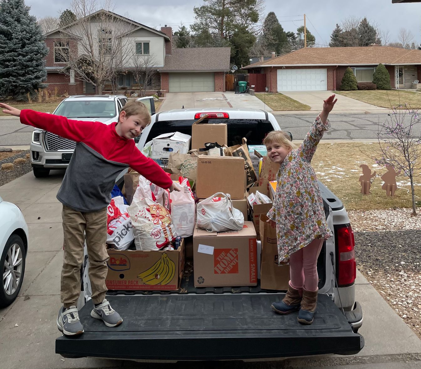 Students with food for food drive.