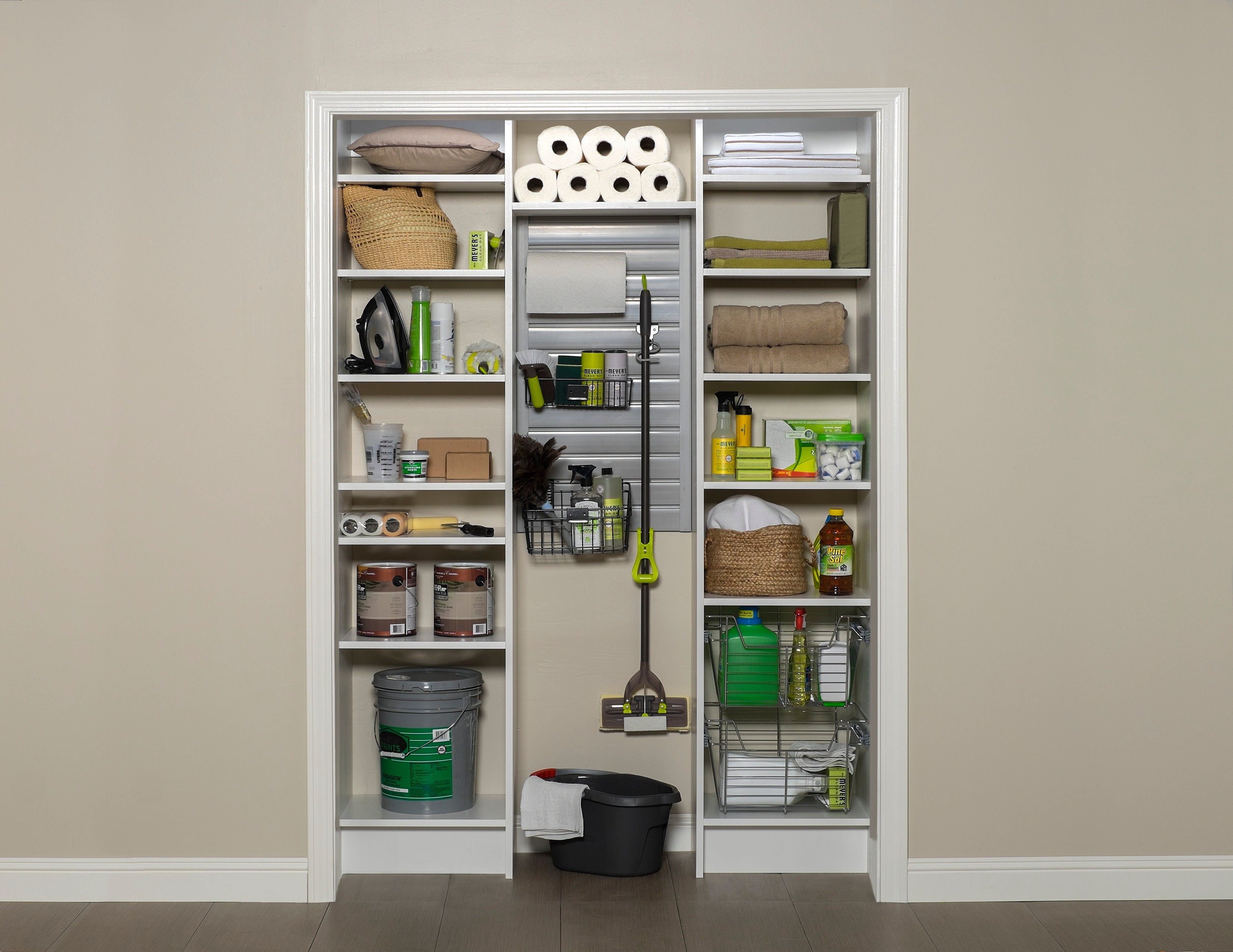 Open closet with items stored in containers