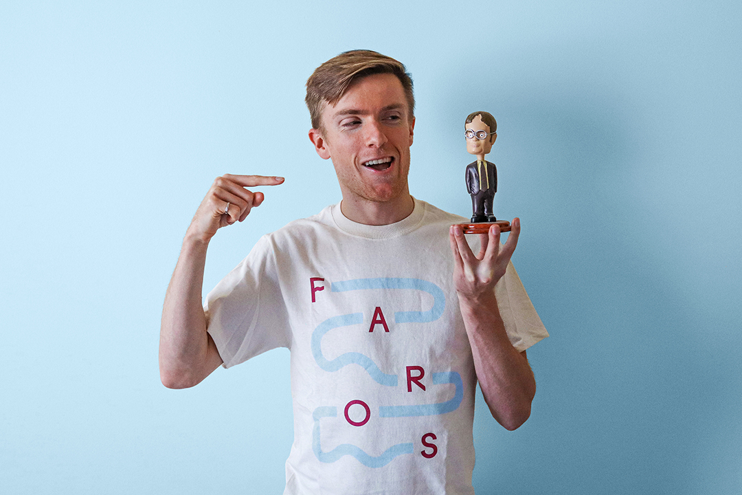 Jack Forbes CEO of Faros holding his Dwight Schrute bobblehead