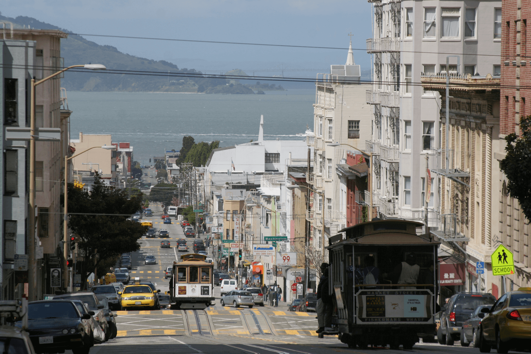 Nob Hill street cars with the Bay in the background