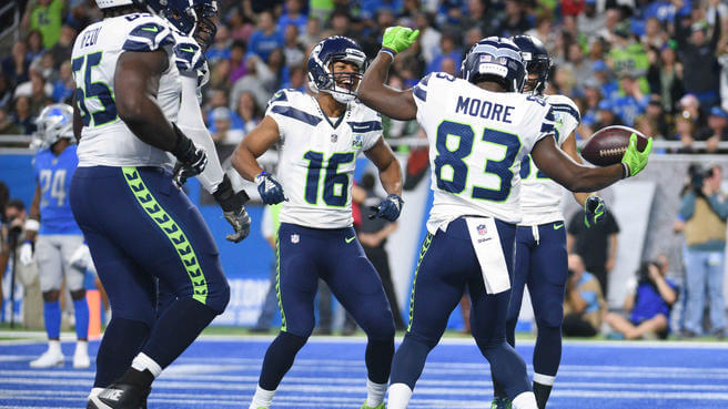 Members of the Seattle Seahawks dance in their endzone after scoring a touchdown against the Detroit Lions