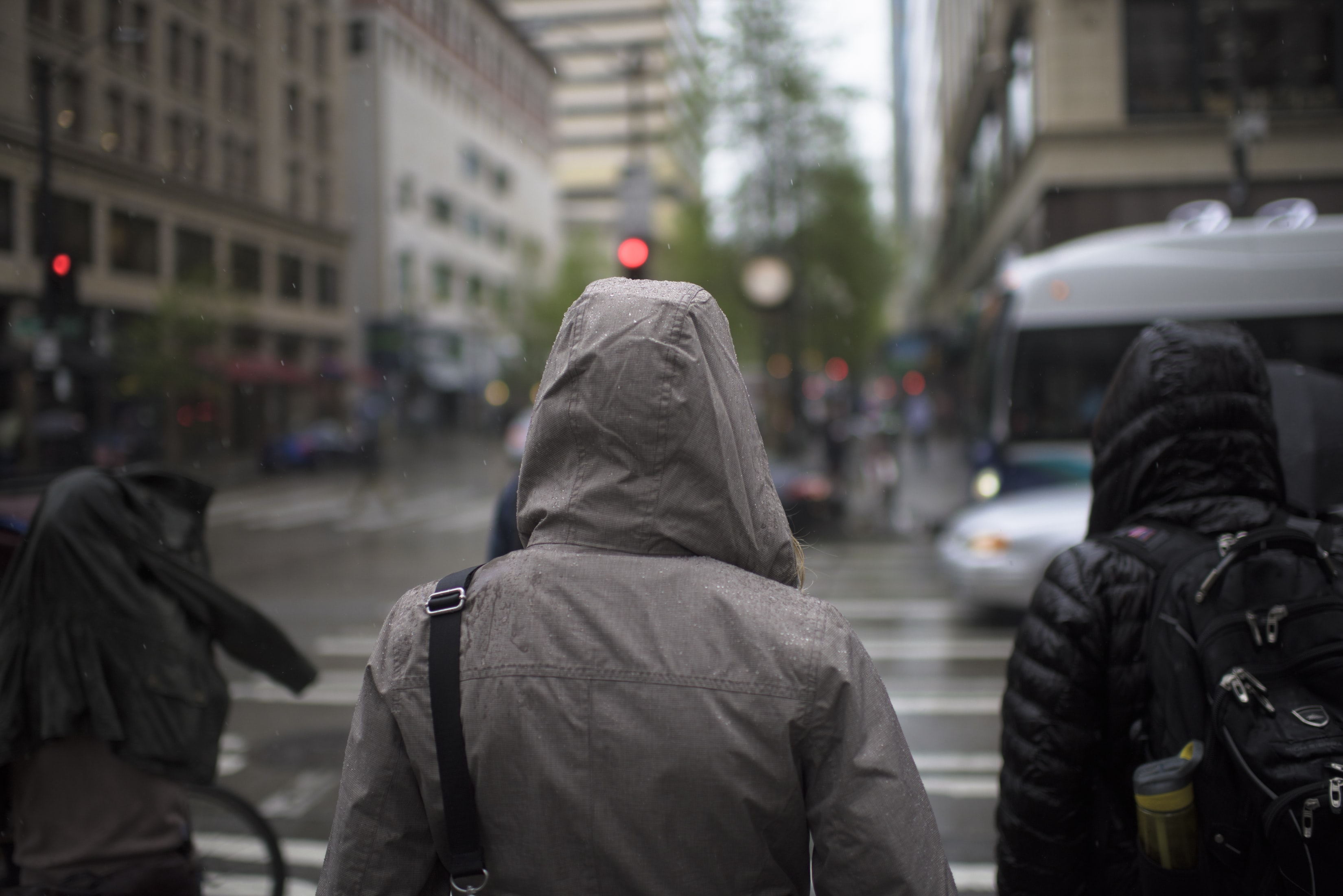 People in downtown Seattle wearing rain jackets