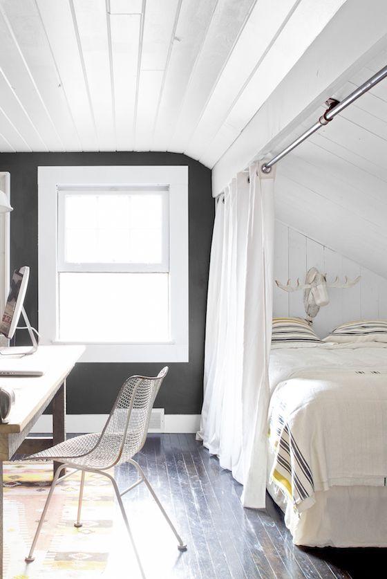 Curtain room divider in multi-purpose bedroom