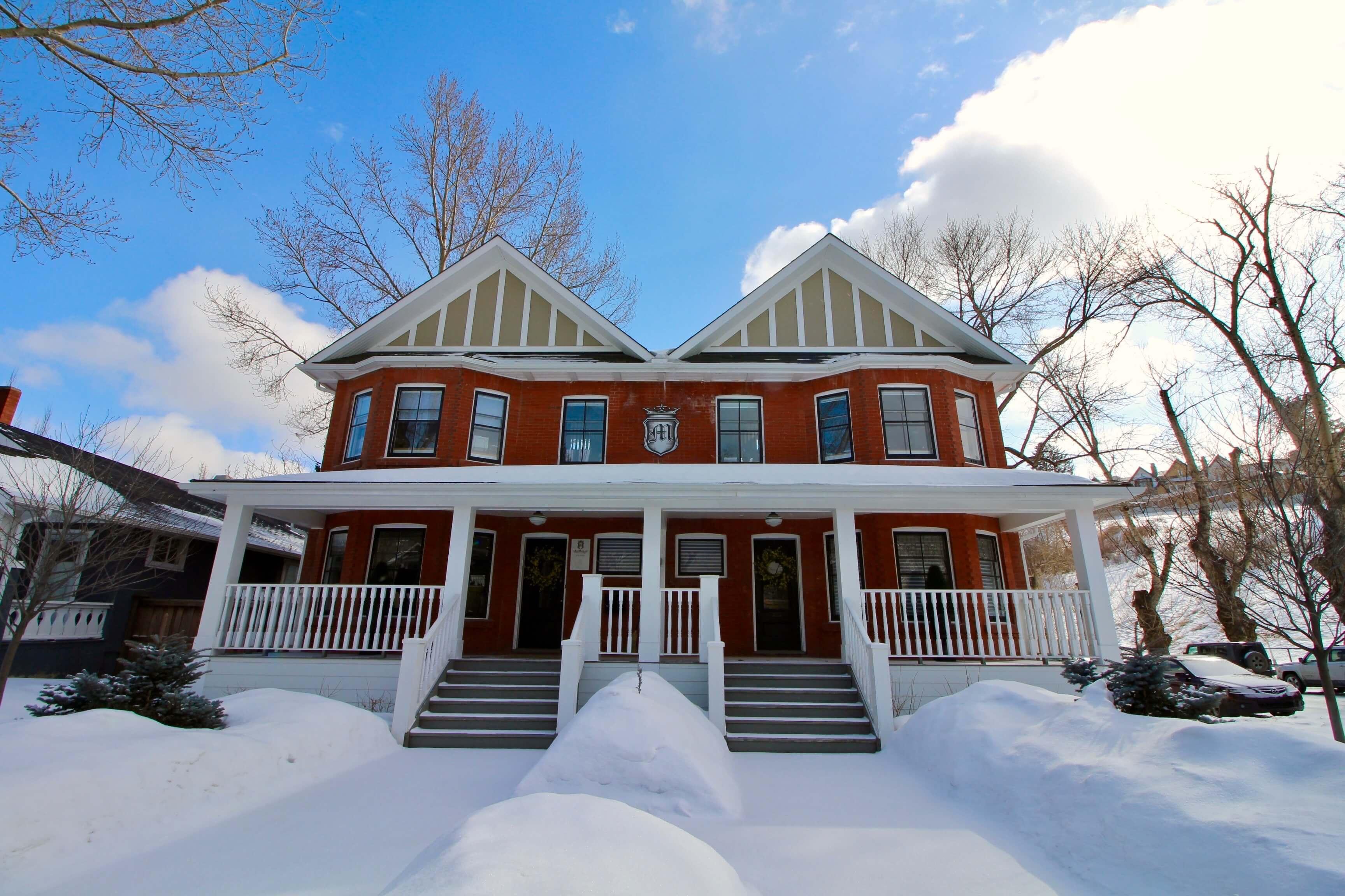 Brick duplex covered in snow