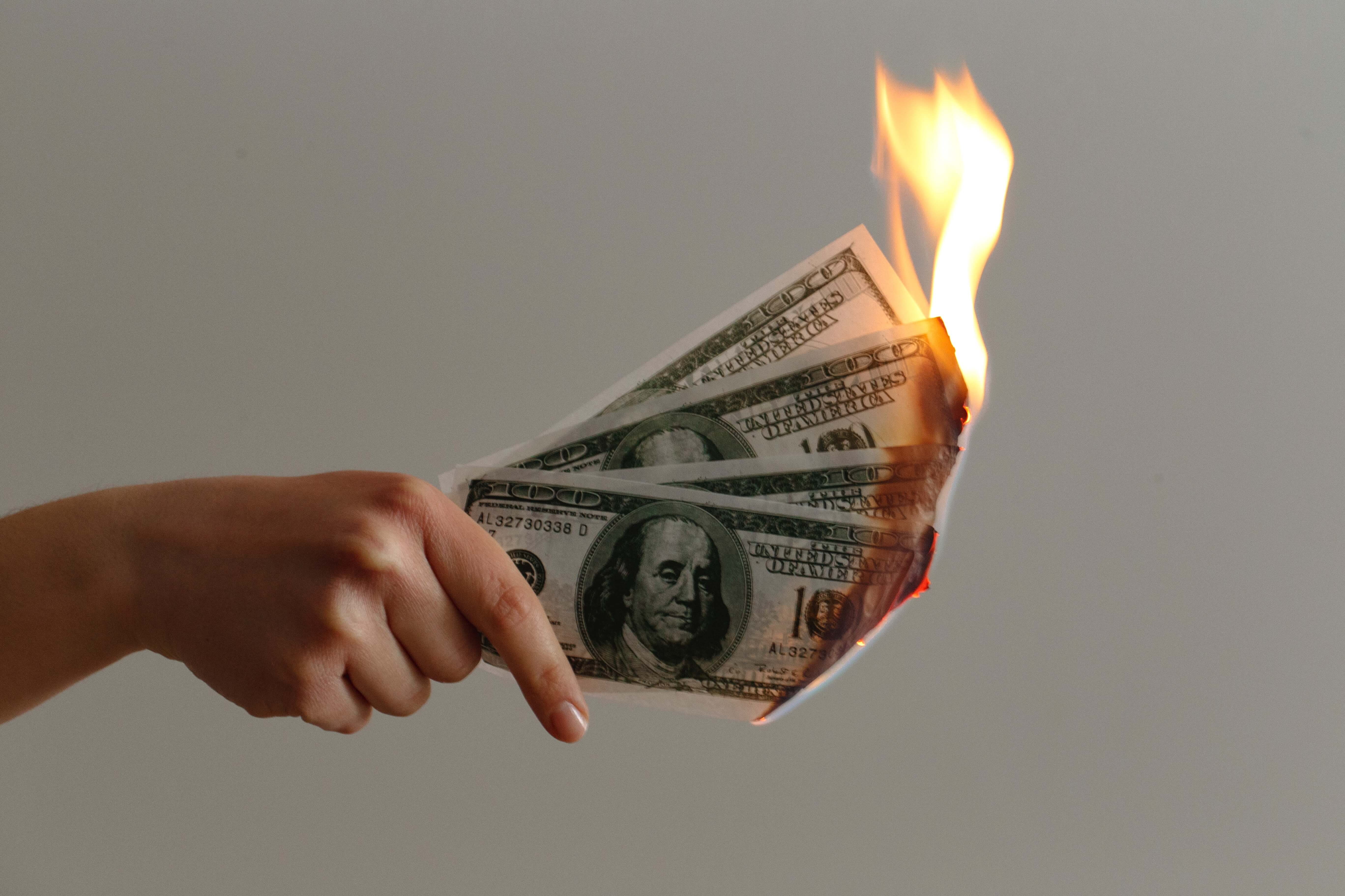 Burning cash money in your hand