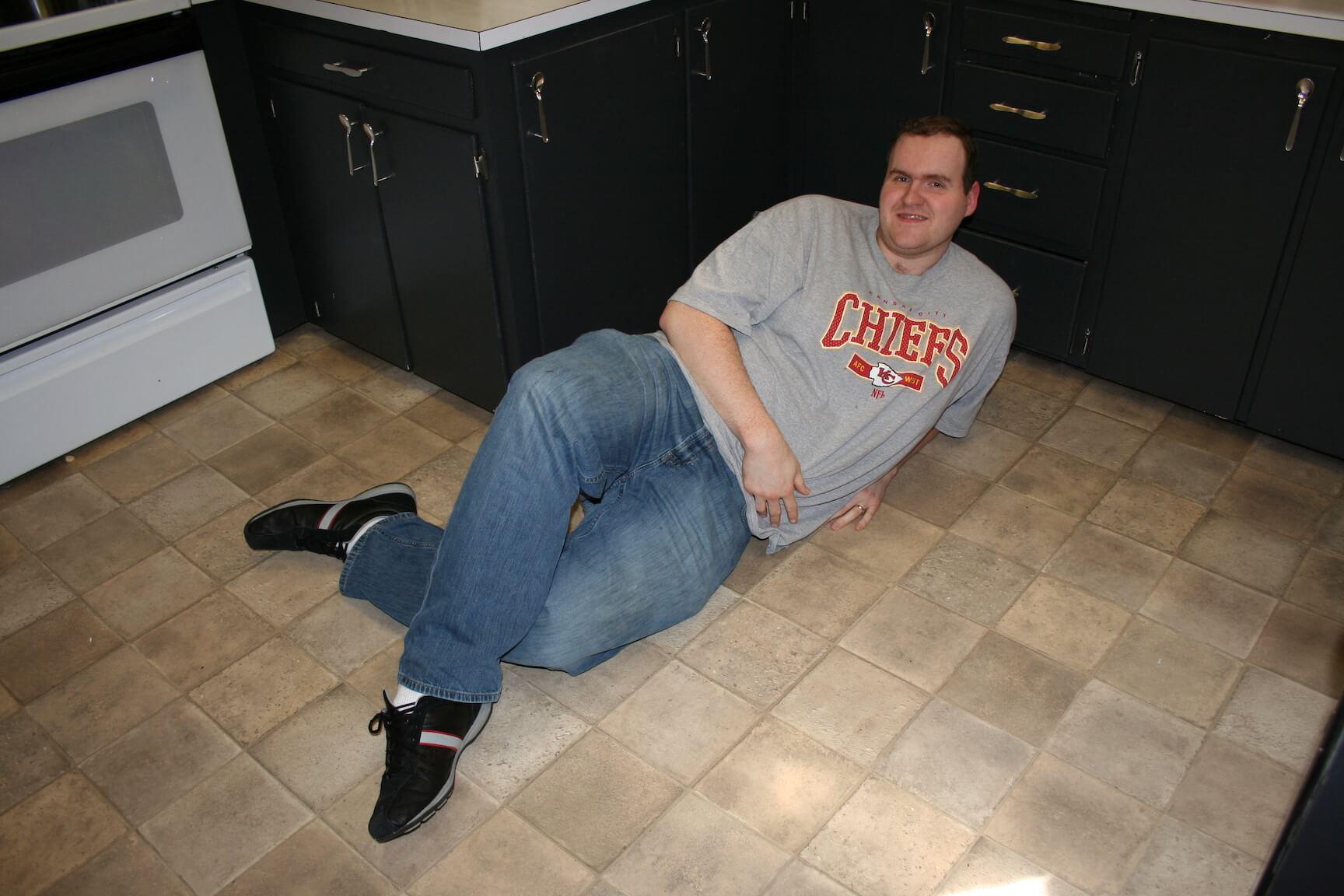 Inconsiderate roommate lying on floor