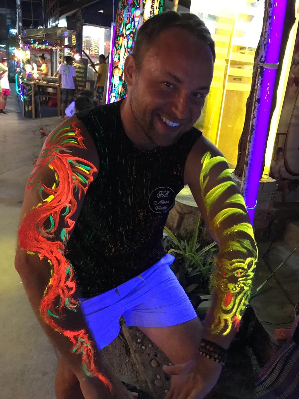 Keith Faros painted glow in the dark tattoos in Thailand