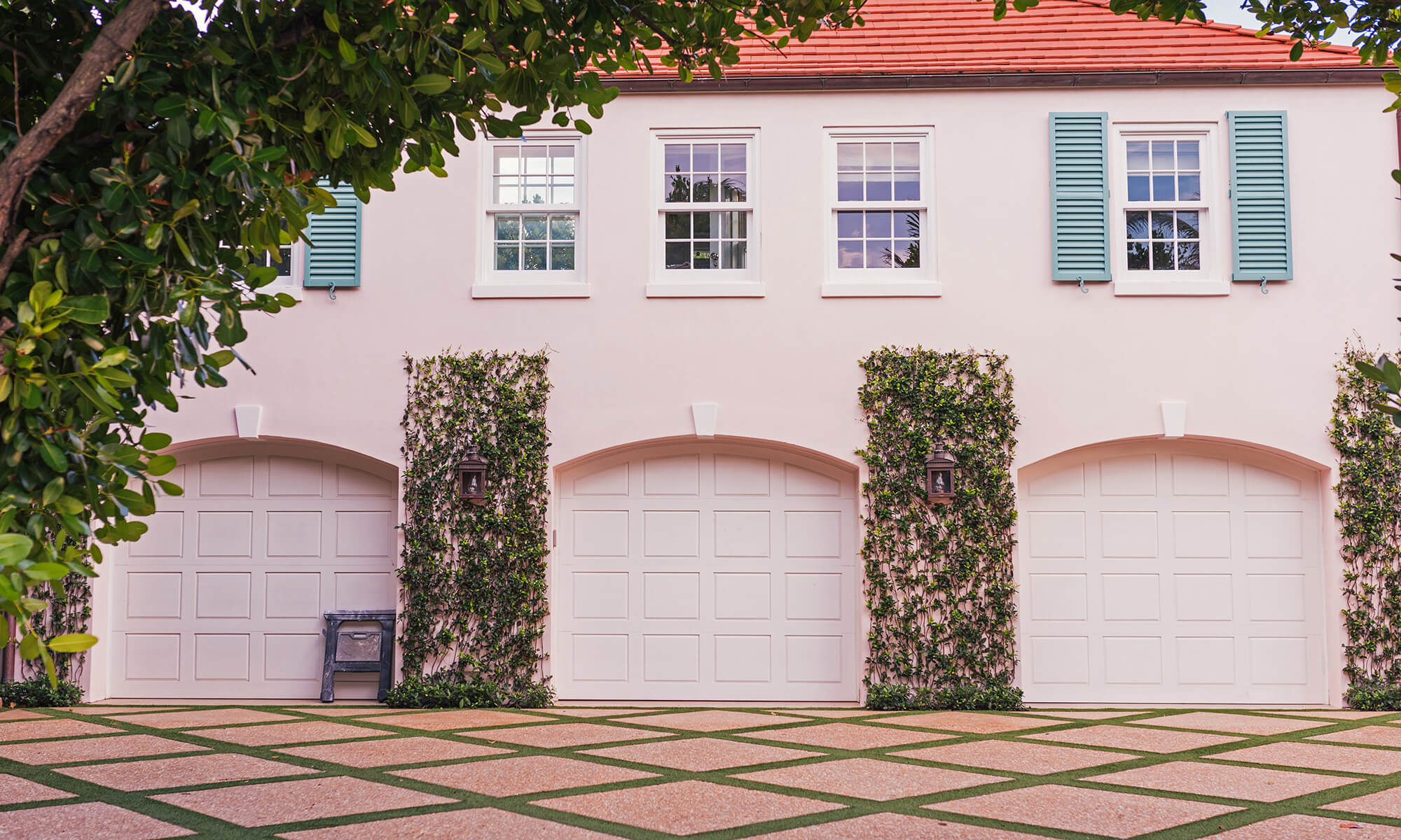 pink house with three garages