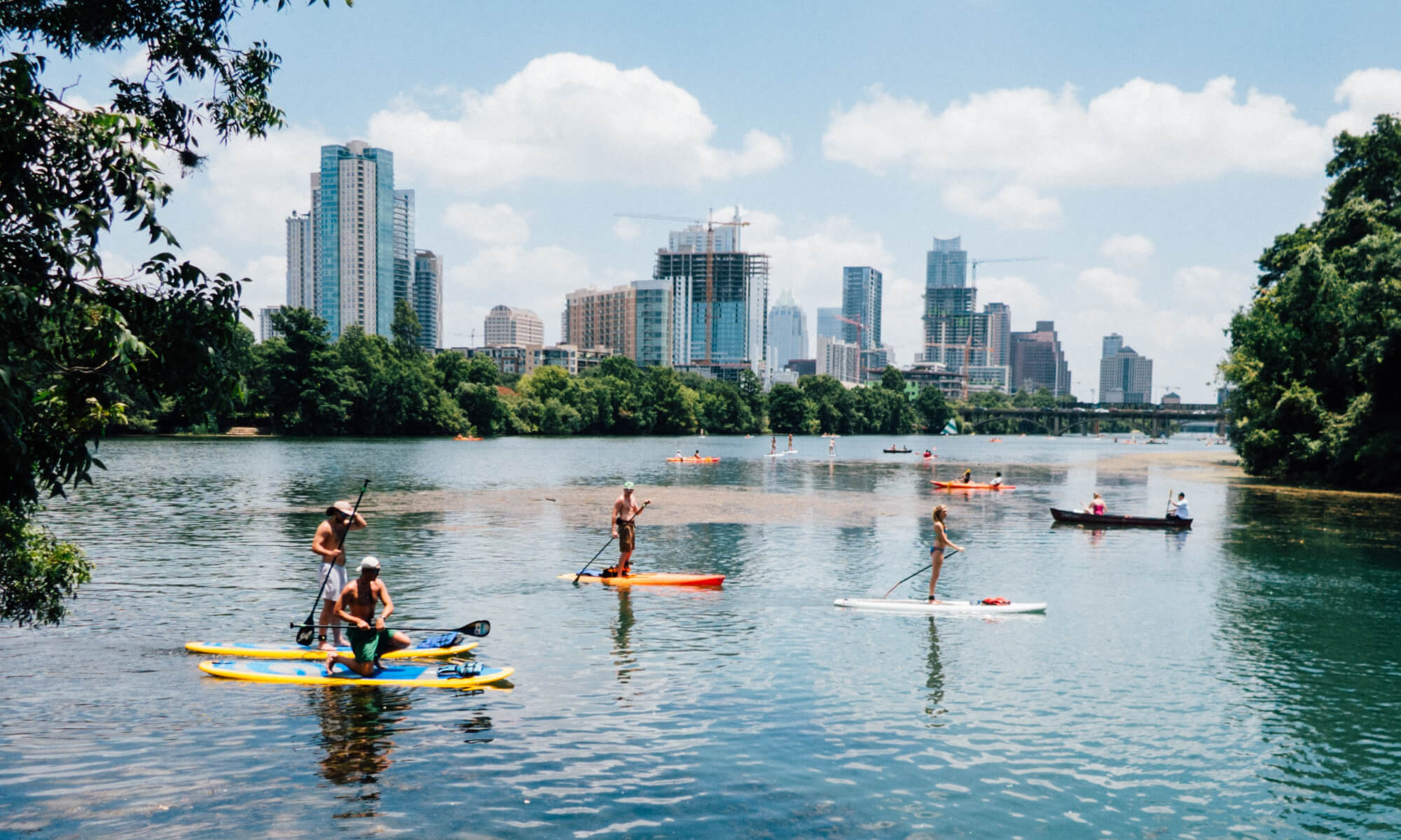 People paddle-boarding on Lady Bird Lake in Austin