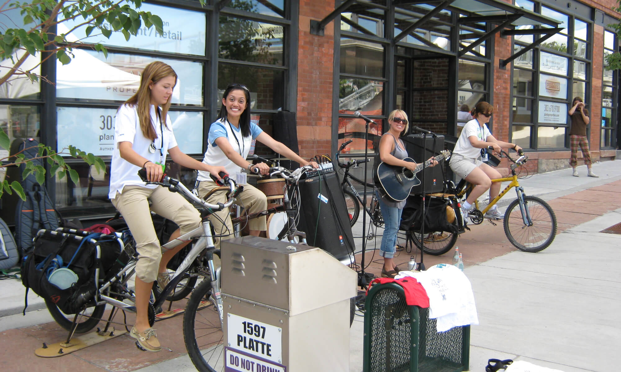 People generating power by cycling in Denver, Colorado