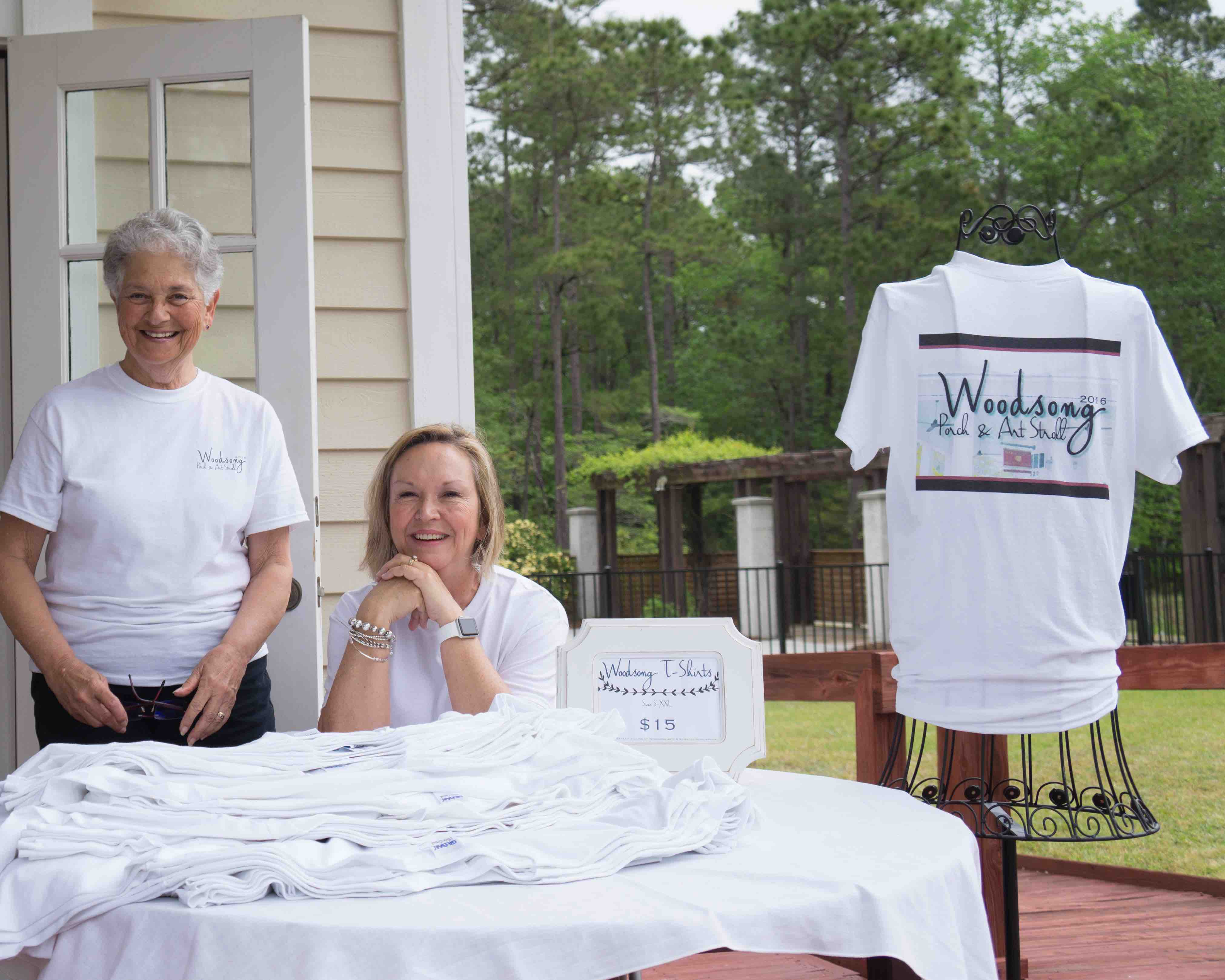 Woodsong residents sell t shirts