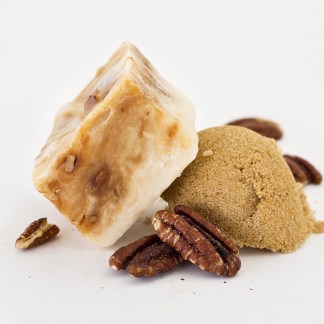 A swirled layer of chewy caramel and pralines surrounded by velvety, smooth vanilla fudge.