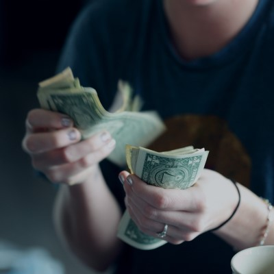 Woman counting money. Photo by Sharon McCutcheon on Unsplash