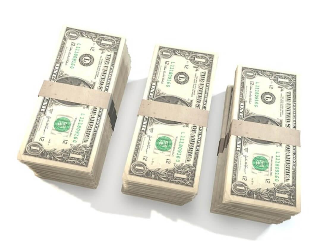 Photo of three stacks of cash