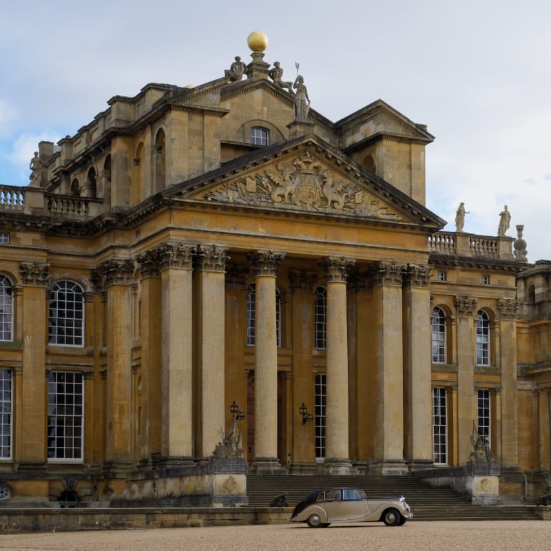 Blenheim Palace, a beige stone palace with large pillers