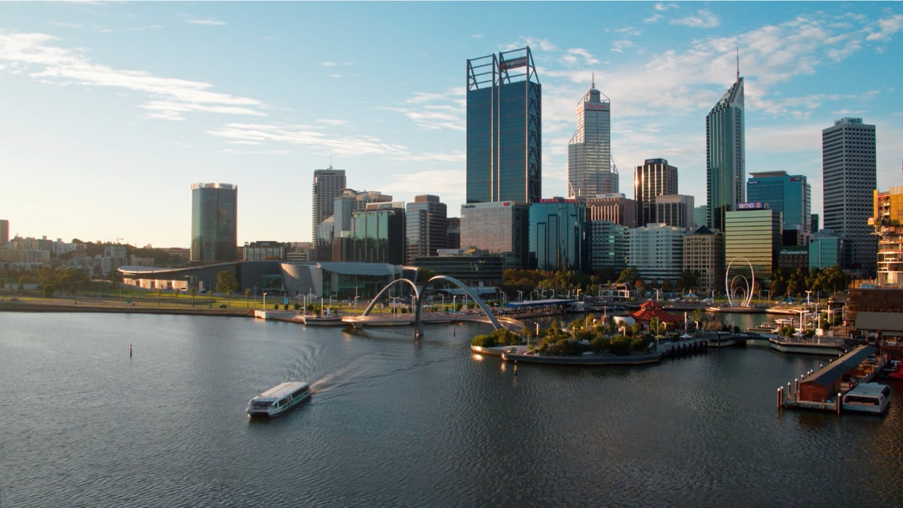 Perth harbour from a helicopter with a boat and city skyline