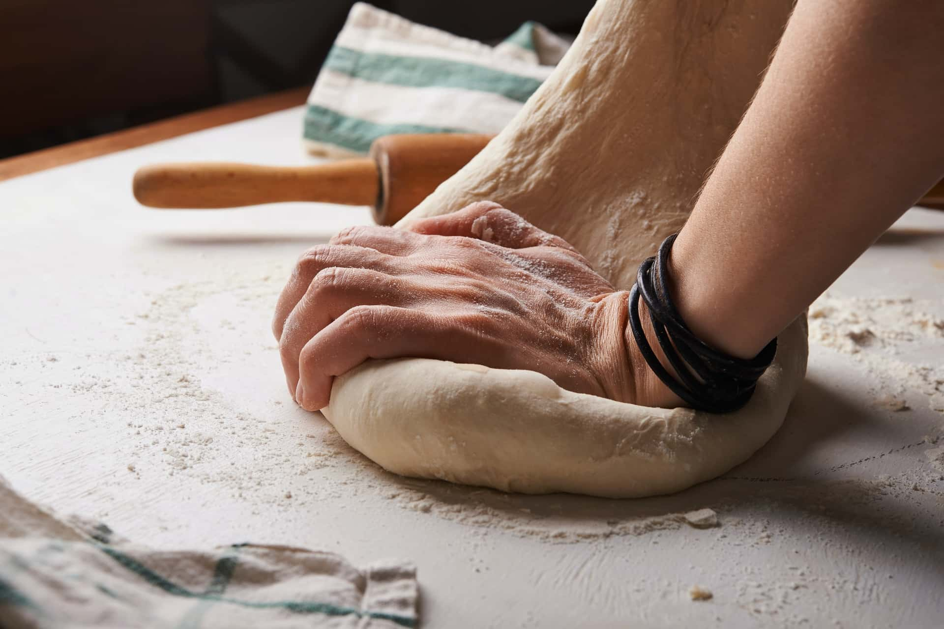 Bread dough being kneaded on a kitchen counter