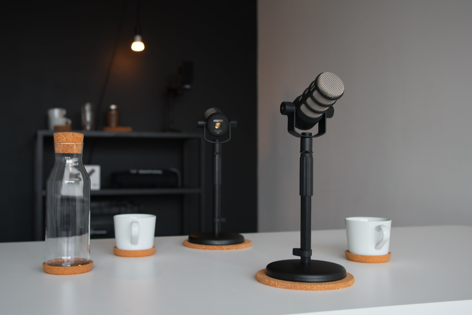 Podcast microphone on a white table in a podcast studio