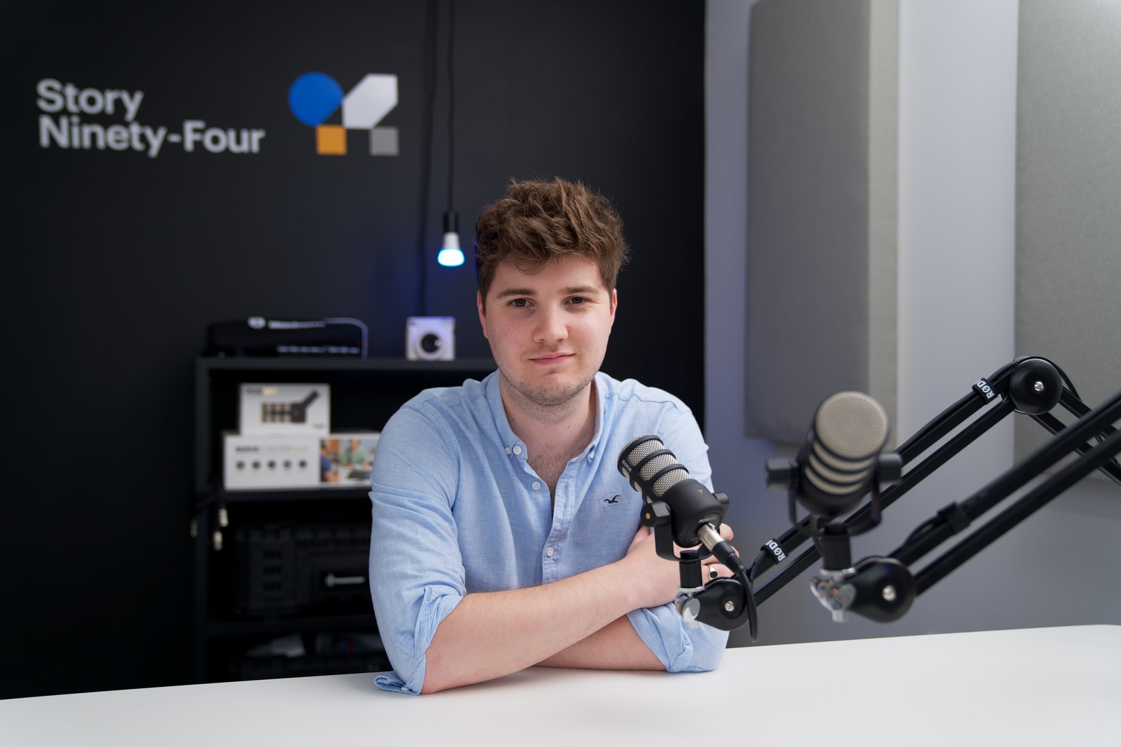 Man sat at table with podcast microphone