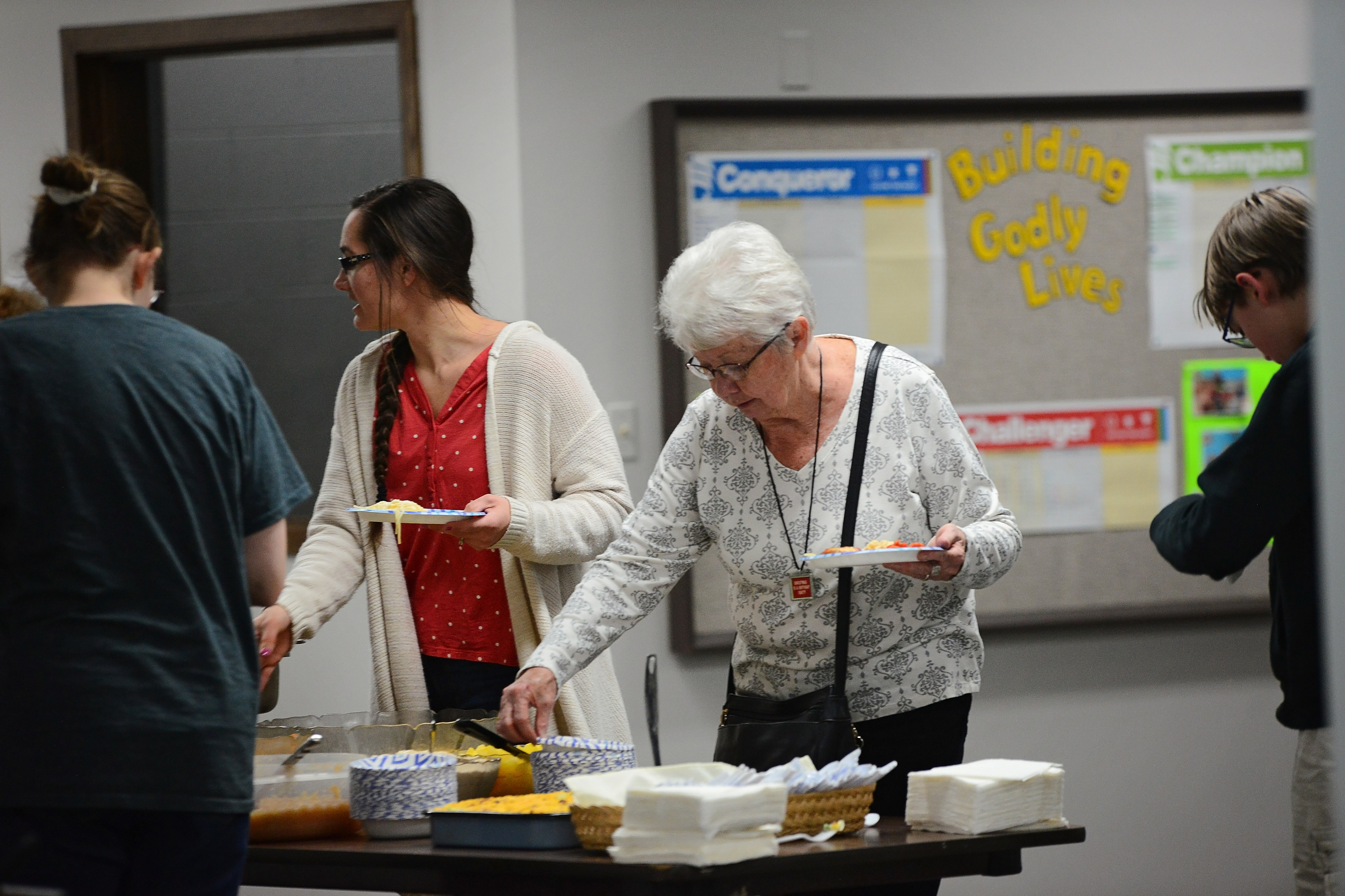Several adults getting food during event