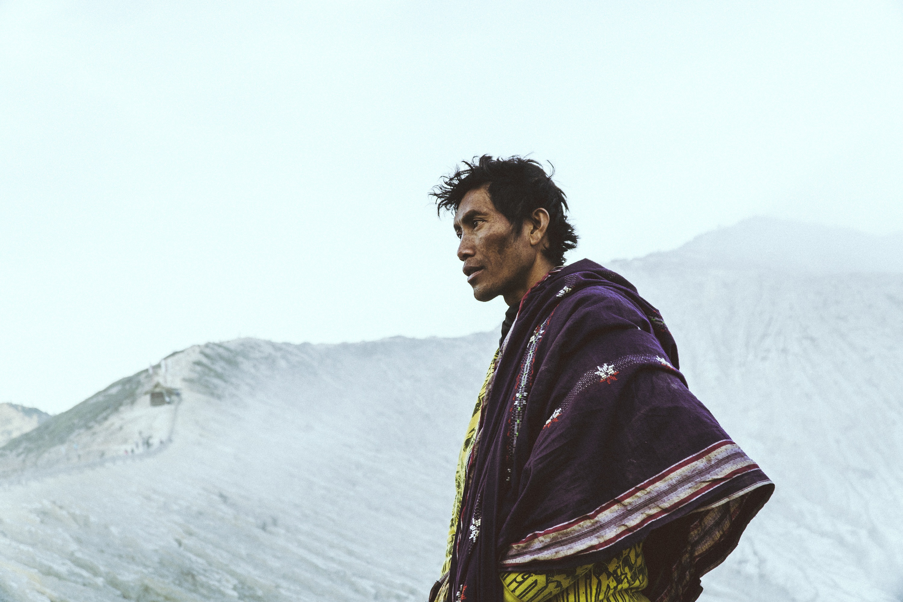 Native man walking in the mountains