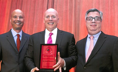 Magellan President, Bob Arthur, and Chicago Bulls Radio Play-by-Play Announcer, Chuck Swirsky, present an award honoring the Chicago Blackhawks to the team's Executive Vice President, Jay Blunk, at the Gilda's Club Chicago 'Agents of Hope' Dinner on June 24, 2014.