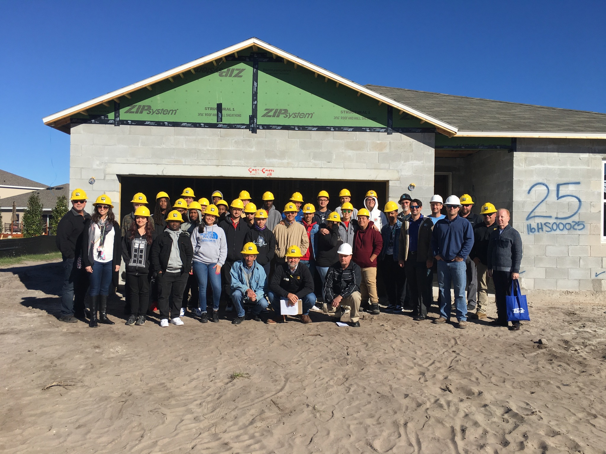 Picture of students from our Construction Pipeline program, at a build site.