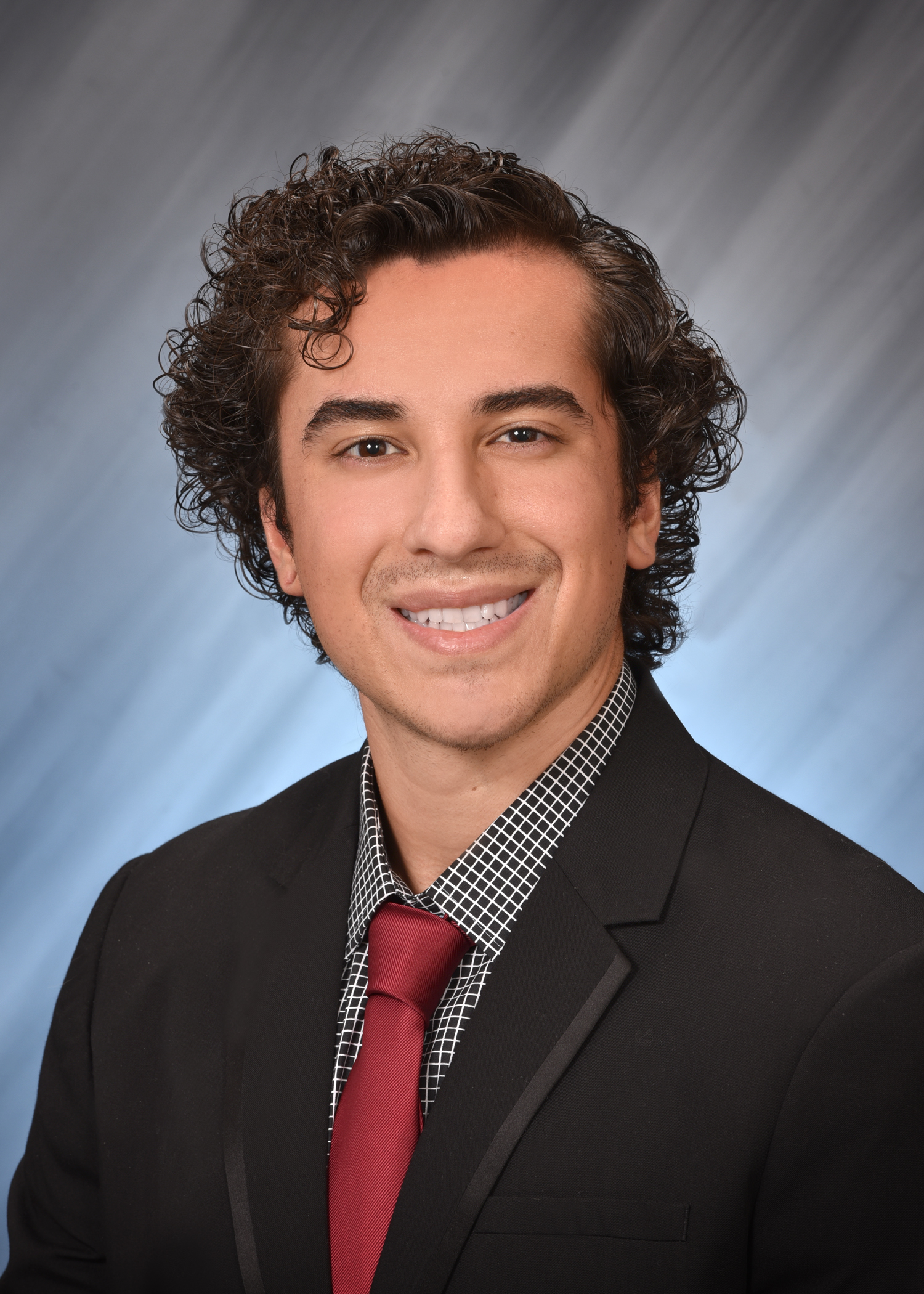 Photo of Christopher Santiago, AGFT Store Manager