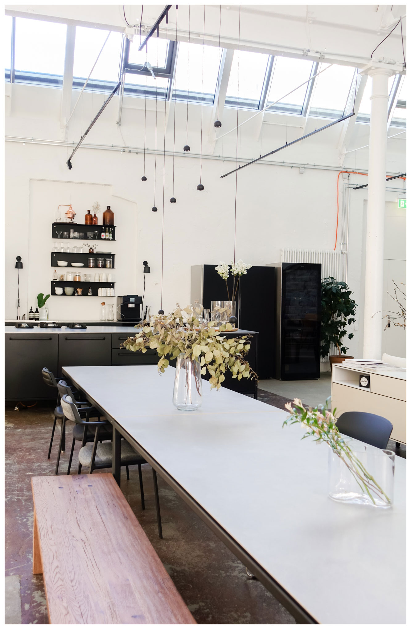 Coworking Office in Zurich with Vipp kitchen and long dining table