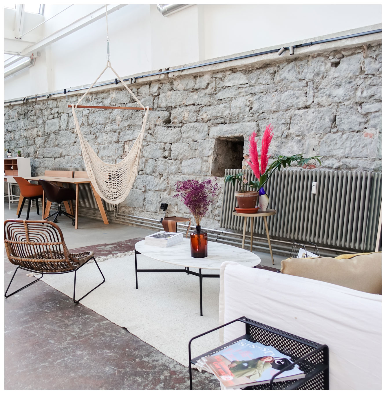 coworking lounge Zurich with natural stone wall and hammock