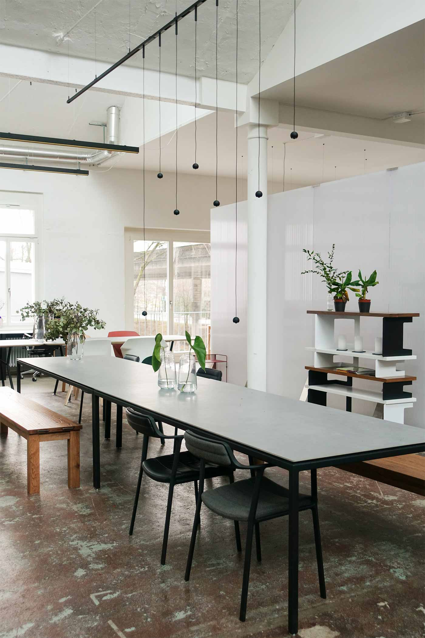 Long coworking office dining table in Zurich