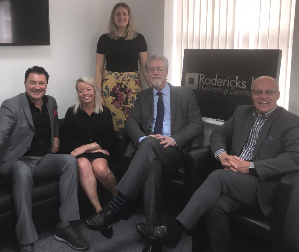 An image of two out of three of the Pluto Partners with the Team at Rodericks Dental
