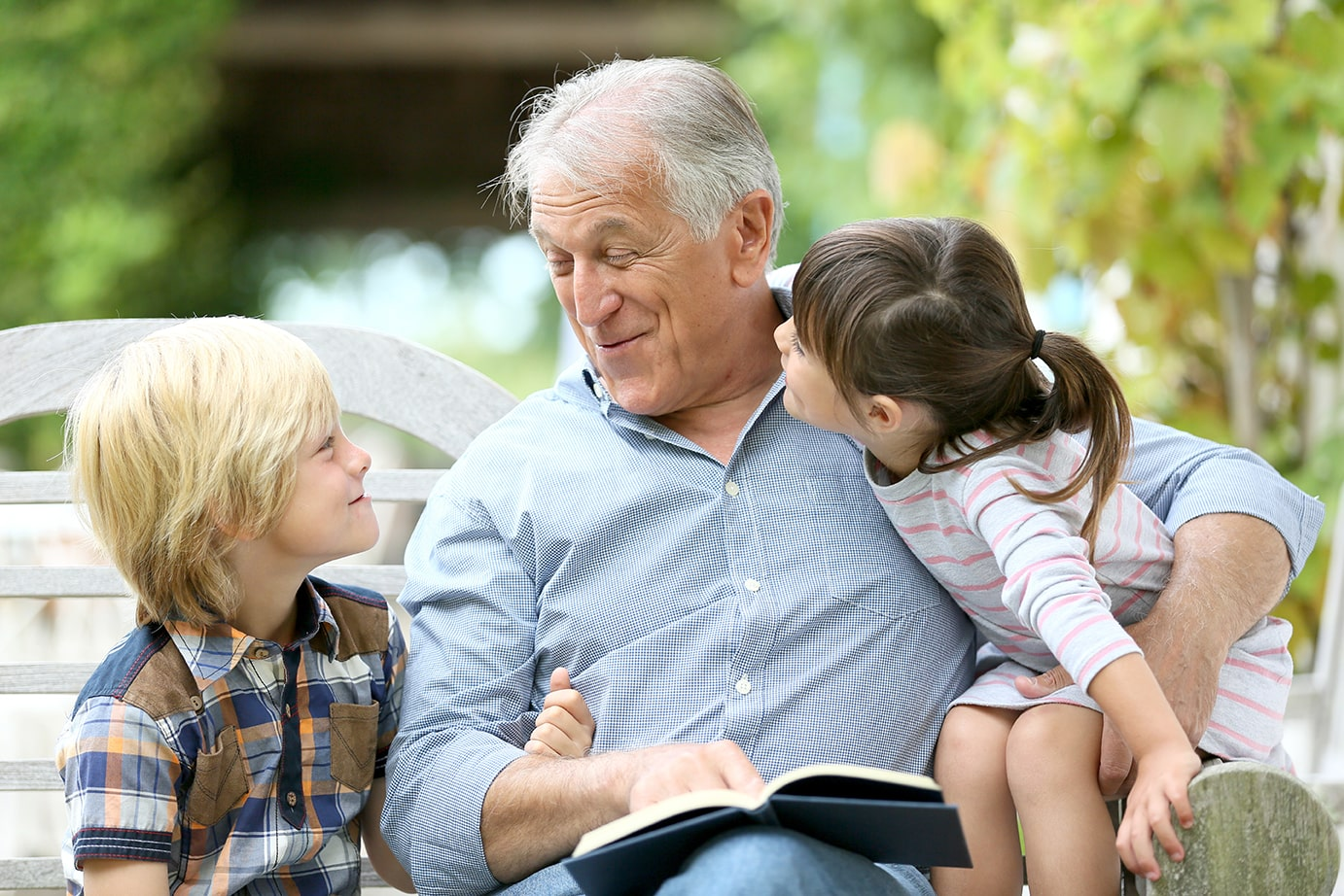 grandfather spending time with grandchildren