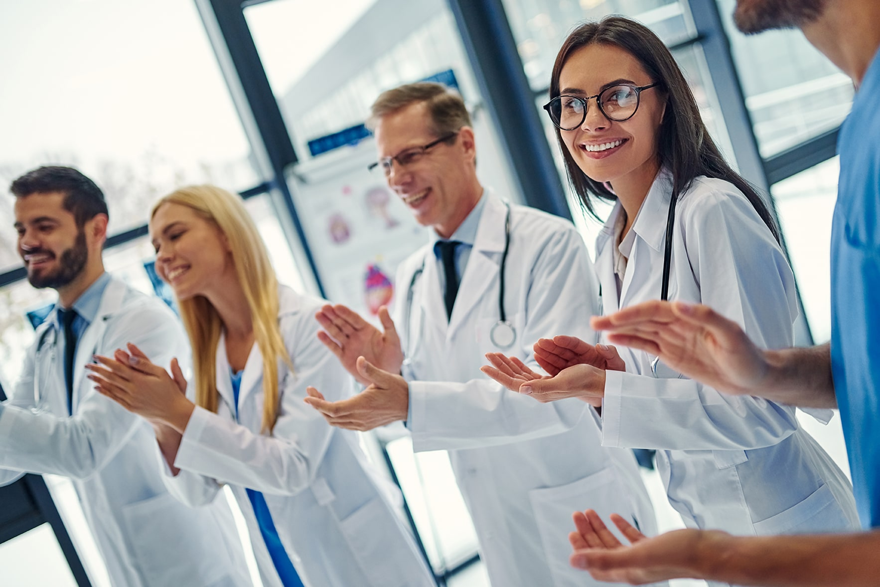 team of doctors applauding new technology