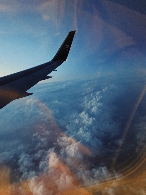 View of the sky from the window of a plane going to the Dominican Republic