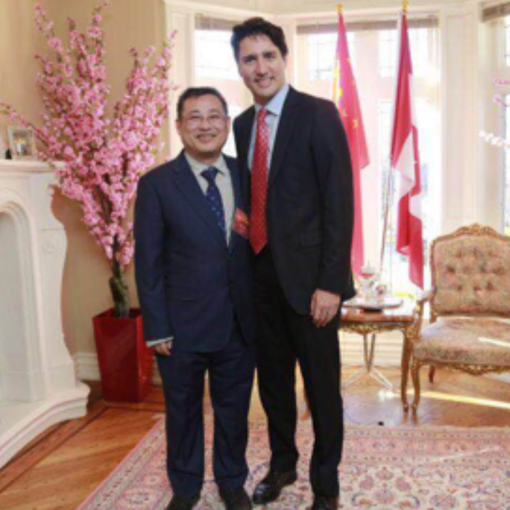 Wei He Waylton Energy Service, with Justin Trudeau