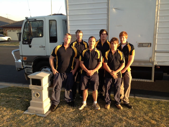 country capital removals team photo