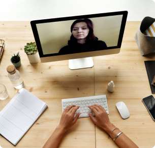 An image of a person working from home having a video meeting