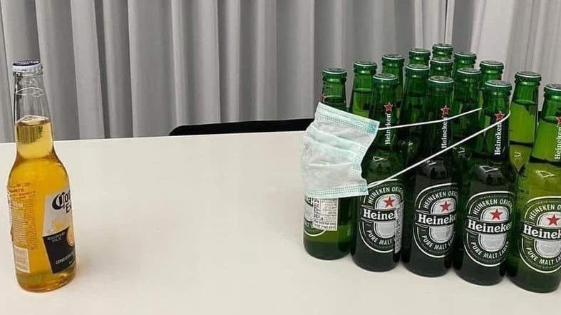 Coronavirus joke: Heinekens with a mask on from Corona beer bottle.